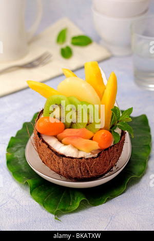 Tropical fruit salad in a coconut. Recipe available. - Stock Photo