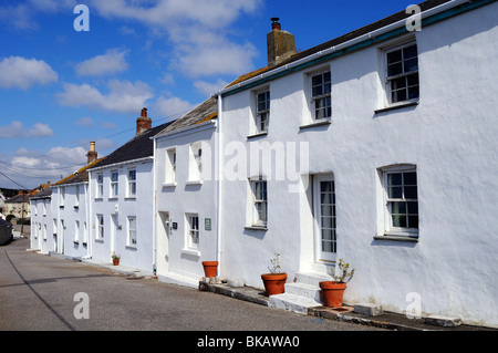 a row of white cottages at porthleven in cornwall, uk - Stock Photo