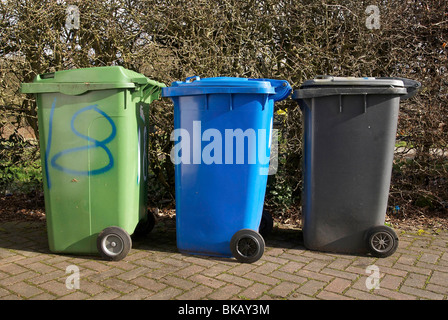 Three wheelie bins green blue and black for domestic refuse collection. - Stock Photo