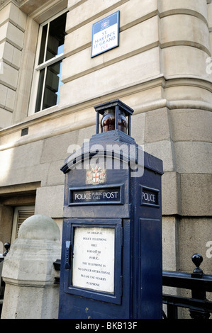 Old blue Police Public Call Post or original police telephone in St Martin's Le Grand City of London England Britain - Stock Photo