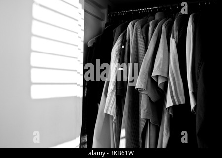 Man Hanging Up Clothes In Closet Stock Photo Royalty Free