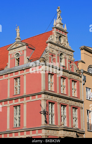 Statue of Pallas Athena and Zeus on top of the tourist office at the Long Market in Gdansk, Poland - Stock Photo