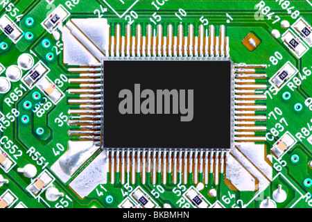 Close up of a computer chip on a circuit board - Stock Photo