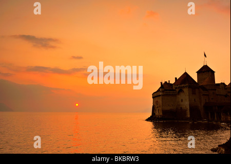 The Chateau de Chillon, on Lac Leman (Lake Geneva) at sunset - Stock Photo