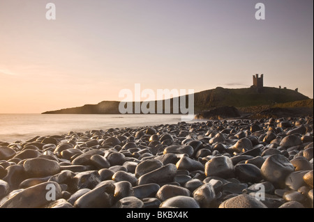 Dunstanburgh Castle viewed from Embleton Bay - Stock Photo