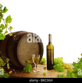 White wine still life with fresh grapevine on white background - Stock Photo