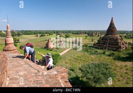 Tourists climbing to the top of a temple. Buledi Group. Bagan. Myanmar