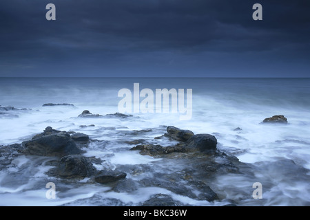 Sea surf and dark clouds at West side cliffs at Santa Cruz, California, USA. - Stock Photo