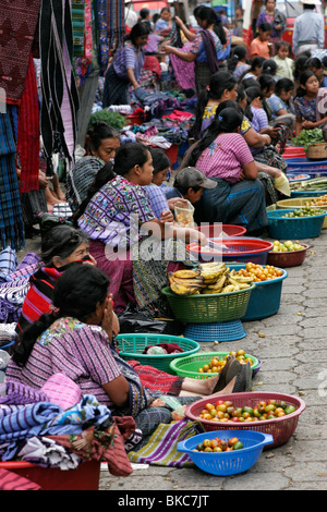 Tzutuhil Maya women dressed in traditional clothes on the market in Santiago Atitlan, Lake Atitlan, Guatemala, Central - Stock Photo