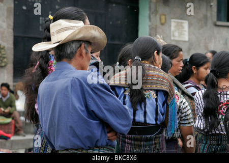 Tzutuhil Maya people dressed in traditional clothes on the market in Santiago Atitlan, Lake Atitlan, Guatemala, - Stock Photo