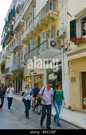Corfu Old Town Locals and tourists stroll around shopping area in old Corfu Town on the Greek island of Corfu Greece - Stock Photo