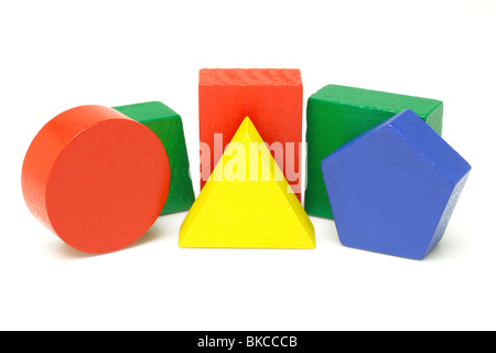 Colorful wooden geometric blocks on white background - Stock Photo