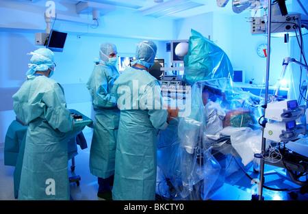 Hospital, surgery operation room, arthroscopic surgery of a hip. - Stock Photo