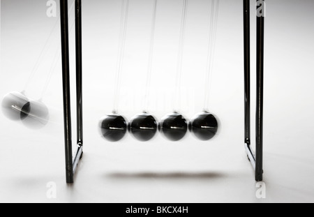 Pendulum, chrome balls, toy, gives impulses. Newton pendulum. - Stock Photo