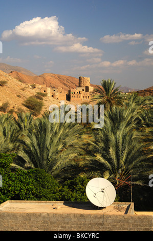 Satellite dish on the roof of a residential building, village of Misfah al Abriyeen, Sultanate of Oman - Stock Photo