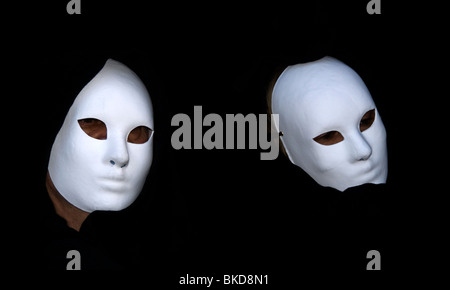 Two Carnival participants wearing costumes and masks in Venice, Italy - Stock Photo
