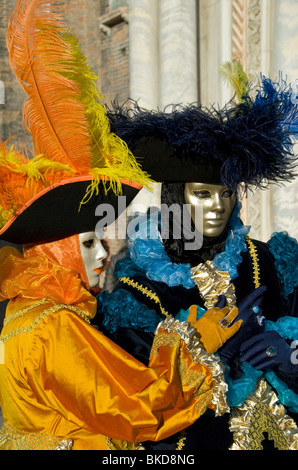 Two Carnival participants wearing costumes in Venice, Italy - Stock Photo