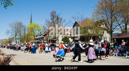 Dancers in traditional dress at the Tulip Festival in Holland, Michigan - Stock Photo