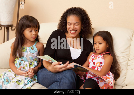 Mother Reading To Her Daughters - Stock Photo