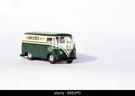 Children's collectible toy model of a volkswagen split screen panel van on white background Advertising Holsten - Stock Photo