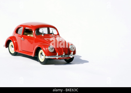 Collectible die cast toy model of a volkswagen beetle on white background - Stock Photo