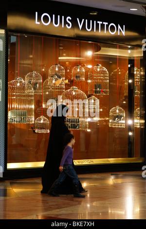 Arabian women at Mall of Emirates , Louis Vuitton shop, shopping mall , Dubai, - Stock Photo