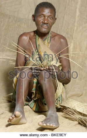Elderly African man weaving in remote North Mozambique Africa. Exclusive photo by explorer Kypros - Stock Photo