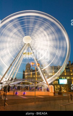 A Ferris Wheel in Manchester city centre UK - Stock Photo