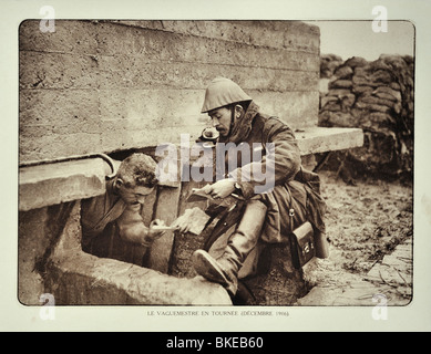 WWI soldier receiving letter from the postman / mail carrier in trench in West Flanders during First World War One, - Stock Photo