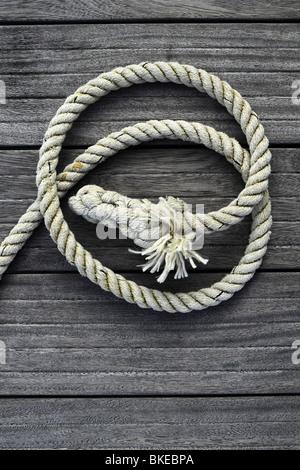 marine rope gray aged teak wood background - Stock Photo