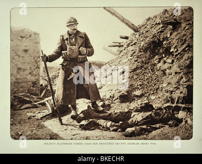 Belgian soldier looking at dead German soldier killed in action in trench at Diksmuide in Flanders, First World - Stock Photo