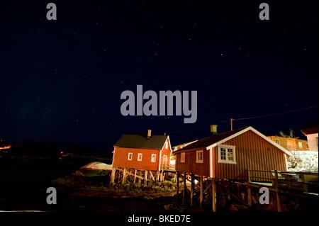 Small fishing houses in night, Svolver, Lofoten, Norway - Stock Photo