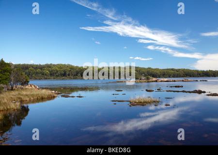 Reflections by Sarah Island (Historic Convict Station), Maquarie Harbour, Western Tasmania, Australia - Stock Photo