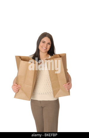 Attractive woman with two brown paper shopping bags. - Stock Photo
