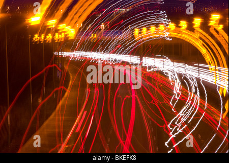 Car lights on the M1 motorway in Leicestershire UK - Stock Photo
