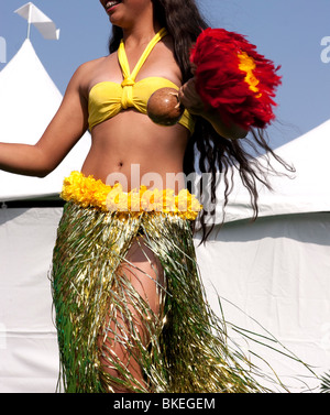 Polynesian dancer performing on stage - Stock Photo