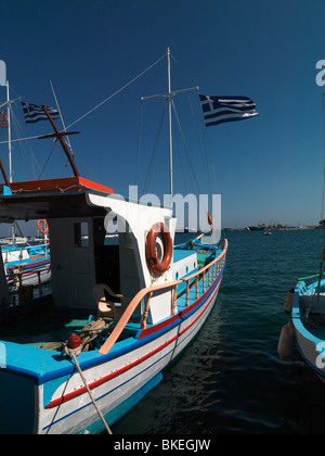 Pythagorion Samos Greece Fishing Boat In Harbour With Cross And Greek Flag - Stock Photo
