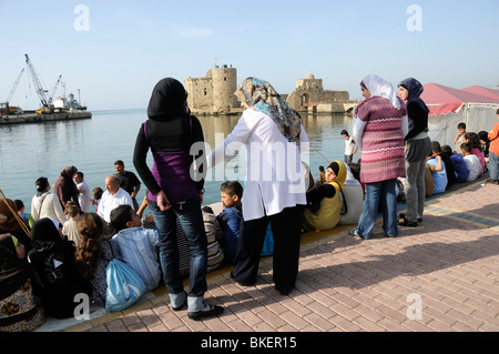 MUSLIM FAMILIES AT THE  HARBOUR AT SAIDA, (SIDON)  LEBANON - Stock Photo