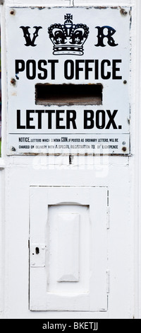 Old Victorian Post Office Letter Box and Sign - Stock Photo