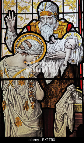 A stained glass window depicting the presentation of Jesus in the Temple, Church of the Holy Cross, Ilam, Derbyshire, - Stock Photo