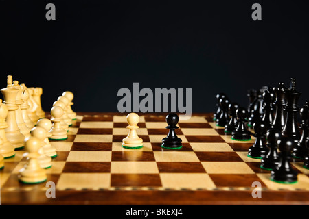 Close up of chess pieces on wooden chessboard - Stock Photo