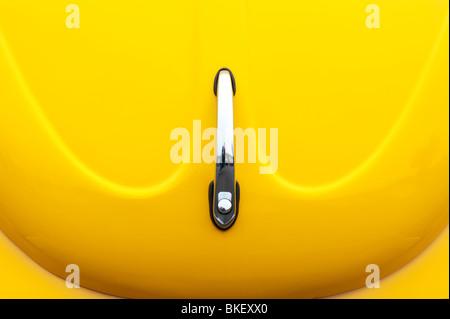 Yellow Volkswagen Beetle bonnet abstract - Stock Photo