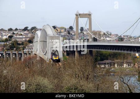 A First Great Western train crossing the Brunel Bridge which runs parallel with the Tamar toll Bridge - Stock Photo