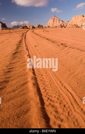 Tyre tracks in the desert of Wadi Rum, Jordan - Stock Photo