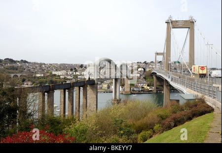 The Brunel railway bridge & the Tamar road bridge which run parallel over the River Tamar Devon and Cornwall southwest - Stock Photo