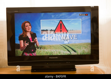 A TV weather forecast, forecasting a heat wave in the UK. - Stock Photo