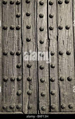 Background Of Old Wooden Door With Metal Studs   Stock Photo