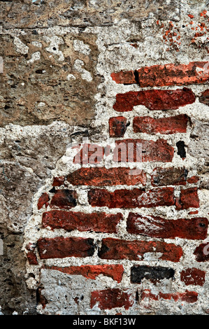 Old red brick and cement grunge wall background - Stock Photo