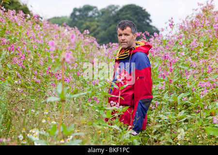 Dr Jeff Warburton from Durham University Geography Department walks through the highly invasive foreign plant, Himalayan Balsam