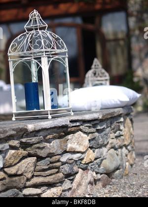 Italian garden candle holders - Stock Photo